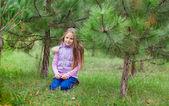 Beautiful girl of conifers — Stock Photo