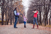 Family walking in the autumn park — Stock Photo