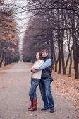 Husband and wife walking in the autumn park — Stock Photo