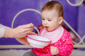 Beautiful baby eating baby food — Stock Photo