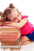 Beautiful girl sleeping on the  books — Stock Photo