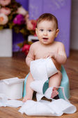 Little baby on potty play with toilet paper — Stock Photo