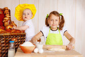 Two children preparing dough — Stock Photo