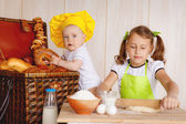 Children knead the dough — Stock Photo