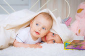 Baby boy playing with sister — Stock Photo