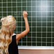Girl writting the equation on the board — Stock Photo #51024823