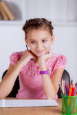 Beautiful girl doing homework. — Stock Photo