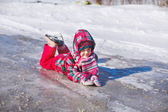 Little girl walking in winter park. — Stock Photo