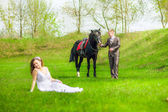 The bride and groom with horse — Foto Stock