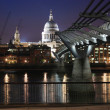 St Paul Cathedral and millenium bridge by night. — Stock Photo