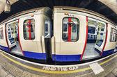 London tube platform edge. Painted warning on the floor — Stock Photo