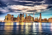Manhattan by night with beautiful sky — Stock Photo
