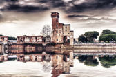 Old building near the river Arno — Stock Photo