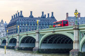 Red doubledecker bus on Westminster Bridge — Stock Photo