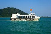 White ship on blue waves. Vietnam. — Stock Photo