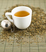 White cup of green tea — Stock Photo
