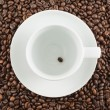 Ceramic cup with one coffee bean — Stock Photo