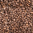 Coffee bean surface as a seamless background — Stock Photo