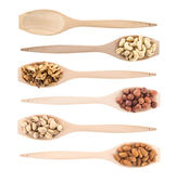 Wooden spoons full of different nuts — Stock Photo