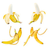 Bananas and peel leftovers isolated over white — Stock Photo