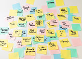 Multicolored paper stickers on wall — Stock Photo