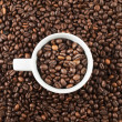 Ceramic cup of coffee beans — Stock Photo