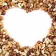 Stock Photo: Heart shaped frame made of nuts