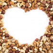 Heart shaped frame made of nuts - Stock Photo