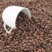 Spilled out of cup coffee beans — Stock Photo