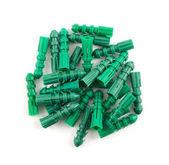 Kunststoff-dübel pin haufen isoliert — Stockfoto