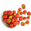 Scattered strawberries in a bowl — Stock Photo