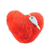 Key over a plush heart — Stock Photo
