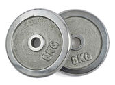 Metal barbell plates isolated — Stock Photo