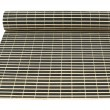 Rolled straw mat isolated — Photo