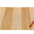 Chopsticks over a bamboo mat — Stock Photo