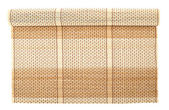 Rolled straw mat isolated — Stock Photo
