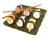 Nigirizushi sushi over nori sheet — Stock Photo
