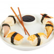 Sushi with soy sauce on a plate — Stock Photo #30385329