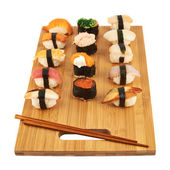 Sushi composition over cutting board — Stock Photo