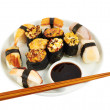 Sushi with soy sauce on a plate — Stock Photo #32926349