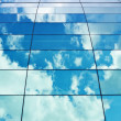 Stock Photo: Sky reflection in building's windows