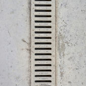 Drain grate in concrete floor — ストック写真