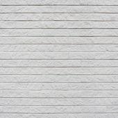 Fragmento de la pared de ladrillo pintado blanco — Foto de Stock