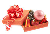 Red gift box full of decorations — Stock Photo