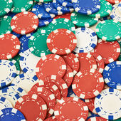 Surface covered with casino chips — Stock Photo