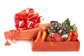 Red gift box full of decorations — Stockfoto