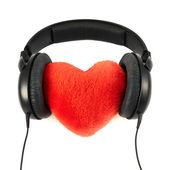 Headphones put on a plush heart — Stock Photo