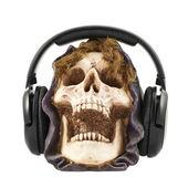 Headphones put on a ceramic skull head — Stock Photo