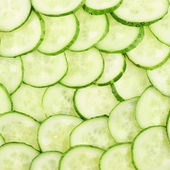 Surface coated with a cucumber slices — Stock Photo