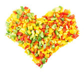 Heart shaped composition of sliced peppers — Stock Photo